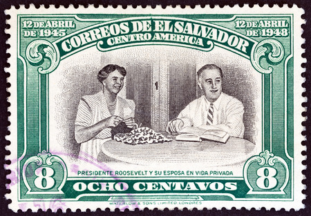 EL SALVADOR - CIRCA 1948: A stamp printed in El Salvador issued for the 3rd death anniversary of Franklin D. Roosevelt shows President and Eleanor Roosevelt, circa 1948.