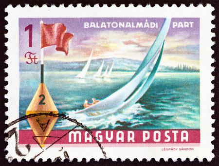 HUNGARY - CIRCA 1968: A stamp printed in Hungary from the Lake Balaton Resorts  issue shows yachts and buoy, Balatonalmadi, circa 1968.