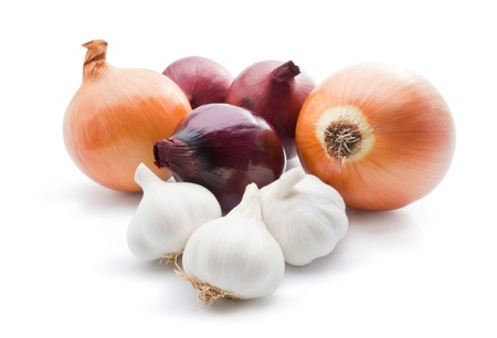 Garlic and onions. Arrangement of different varieties of onions with garlic close-up isolated on white background