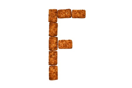 Alphabet made up of cookies on a white isolated background. letter F