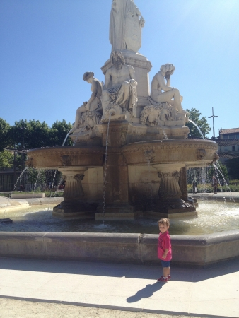 Child at fountain in Nimes France