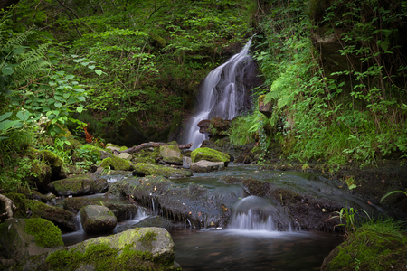 Waterfall at Rhigos A waterfall on the confluence of Nant Gwrelych and Nant Llyn Fach rivers near Glynneath and Rhigos, South Wales.