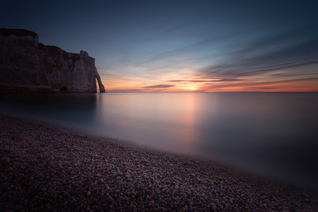 Sunset at the beautiful coastline of Etretat, a commune in the Seine-Maritime department in the Normandy region of north western France
