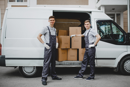 Photo for Two young handsome smiling workers wearing uniforms are standing - Royalty Free Image