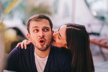 Photo pour Loving couple. Girl bites her boyfriends ear - image libre de droit