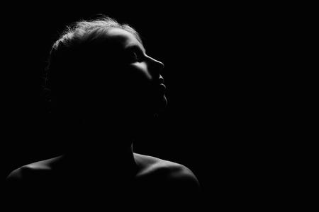 Photo pour female profile on black background monochrome image with copyspace - image libre de droit