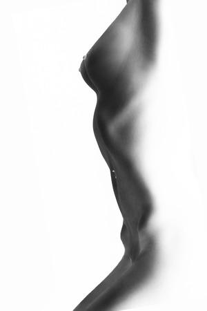 Photo pour naked tan female body on black background, monochrome negative image - image libre de droit