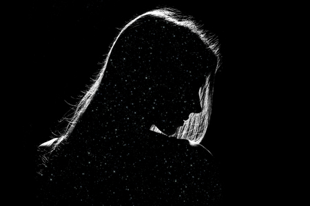 Foto de sad woman profile silhouette in dark with stars inside, monochrome image - Imagen libre de derechos