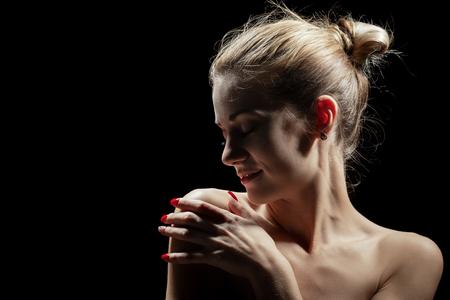 Photo pour beautiful female profile with bare shoulders on black background - image libre de droit