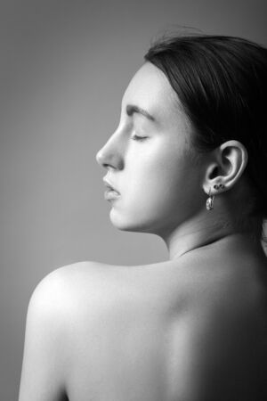Photo pour beautiful woman profile silhouette with closed eyes isolated on gray background, monochrome - image libre de droit