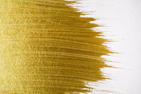 Foto de Gold acrylic paint texture on white paper background art object design - Imagen libre de derechos