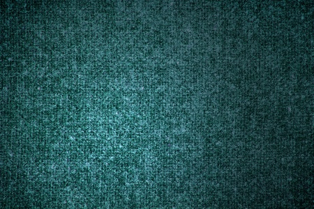 Background a texture a knitted woolen fabric of dark green color