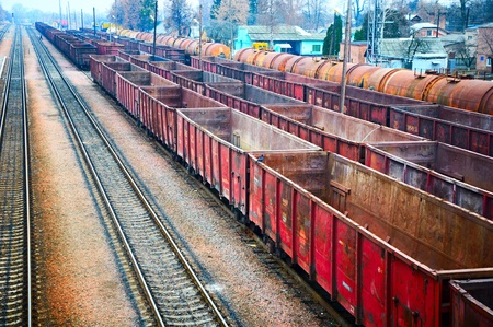 Empty railway containers for transportation covered with a rust