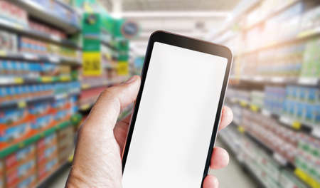 Foto für Human hand holding mobile phone and using mobile app order online from supermarket, Concept shopping online for recive discount - Lizenzfreies Bild