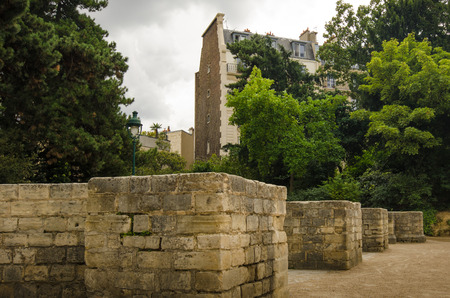 Paris, France, September 4, 2015 - The stone seating alcoves for the wealthy and ruling class at Arenes de Lutece is among the remains of one of the largest amphitheaters built by the Romans.