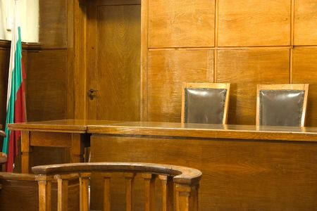 Old vintage court room. Close-up of the judges chairs.