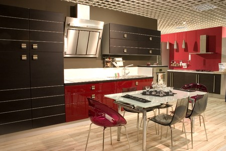 Modern kitchen and dining room with stylish furniture. Dining table adn chairs.