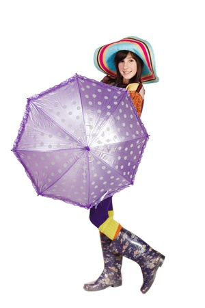 Beautiful girl with umbrella isolated on whiteの写真素材