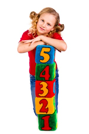 Happy girl holding blocks with numbers over white background