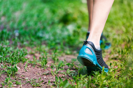 Closeup of running shoes of woman barefoot. Female jogging in the park.の写真素材