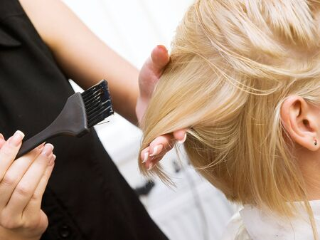 Photo for Hair coloring in a beauty salon in blonde. Hairdressing services. - Royalty Free Image