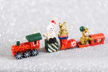 Photo pour christmas bauble, wooden toy on silver blurred glitter background with copy space - image libre de droit