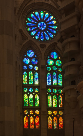 Foto de Geometric stained glass designs in Sagrada Familia windows, Barcelona, Spain. Each unit is named after a person or place of religious significance and relevance to the basilica. - Imagen libre de derechos