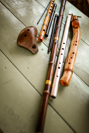 Different folk flutes from wood and steel.