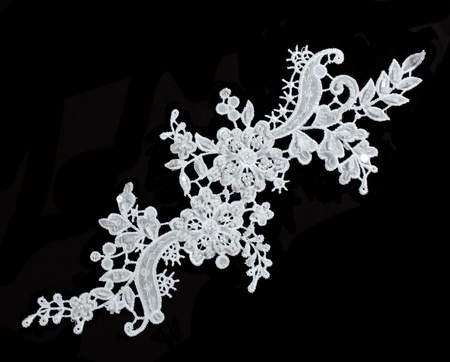 Photo pour luxury wedding lace with pearls isolated on black background - image libre de droit