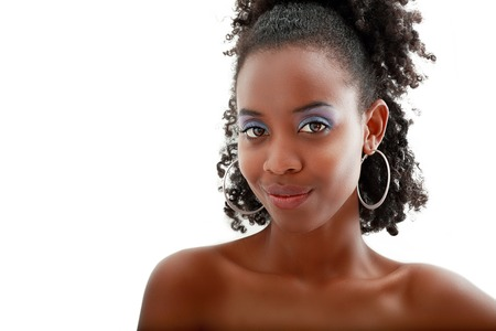 Beautiful black woman face with perfect make up over white