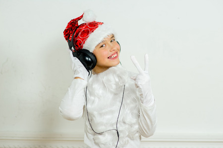 boy pretending he is a Bad Santa with chains, headphones