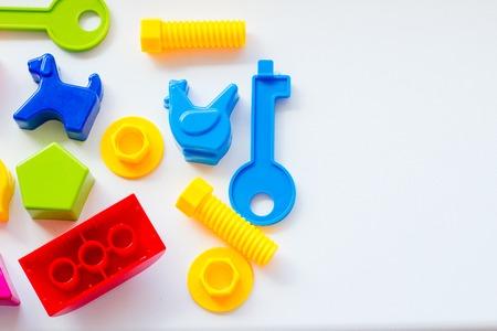 Foto de Set of toys for babies on a white table - Imagen libre de derechos