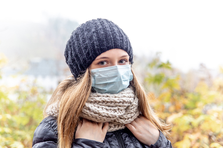 Photo for Cold and flu. Woman with a medical face mask - Royalty Free Image