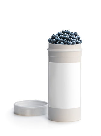 Photo pour Swap  your pills to a fresh blueberry. Concept of nature made vitamin supplement from natural berries - image libre de droit