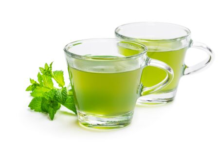 Photo pour Green  mint tea in clear glass cups isolated on white - image libre de droit