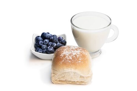 Photo for Freshly  baked wheat bun with blueberry and glass of milk isolated on white  - Royalty Free Image