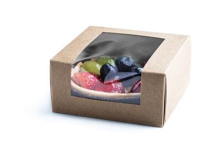 Foto für Fresh  fruit tart with berries in small card box isolated on white - Lizenzfreies Bild