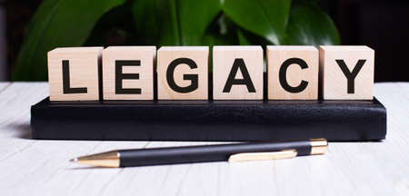 Photo pour The word LEGACY is written on the wooden cubes of the diary near the handle. - image libre de droit