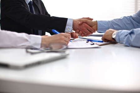Photo for Business meeting at the table shaking hands conclusion of the contract. - Royalty Free Image