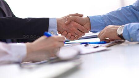 Foto de Business handshake. Two businessman shaking hands with each oth - Imagen libre de derechos