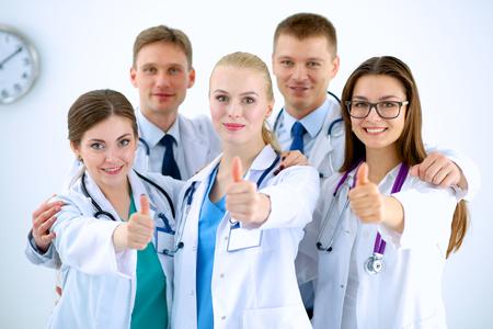 Foto de Portrait of doctors team showing thumbs up - Imagen libre de derechos