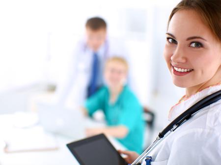 Photo pour Young woman  doctor holding a tablet pc - image libre de droit