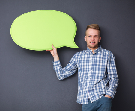 Man holding white blank speech bubble with space for text .