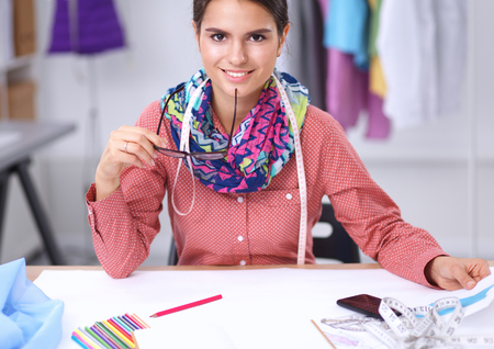 Photo for Modern young fashion designer working at studio. - Royalty Free Image