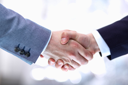 Photo pour Businessmen shaking hands, isolated on white background. - image libre de droit