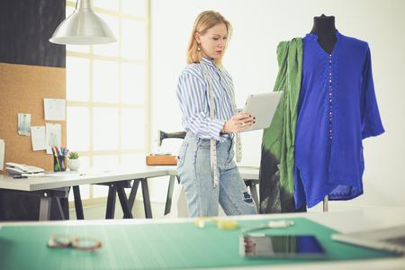 Photo pour Fashion designer working on her designs in the studio - image libre de droit