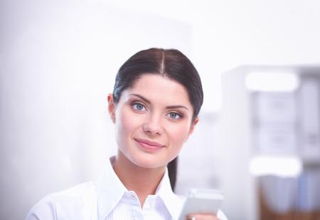 Photo pour Attractive businesswoman sitting in the office. businesswoman - image libre de droit