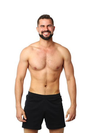 Photo for Portrait of a happy athletic man with muscular torso standing - Royalty Free Image