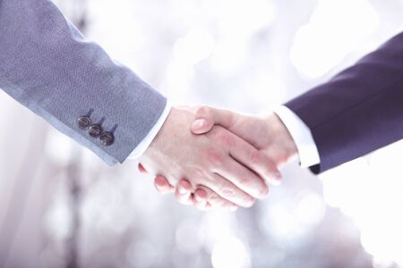Photo pour Closeup of a businessman hand shake businesswoman between two colleagues OK, succeed in business - image libre de droit