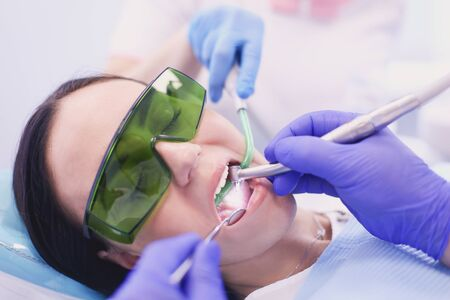 Foto de Dental team and patient at dentists surgery - Imagen libre de derechos